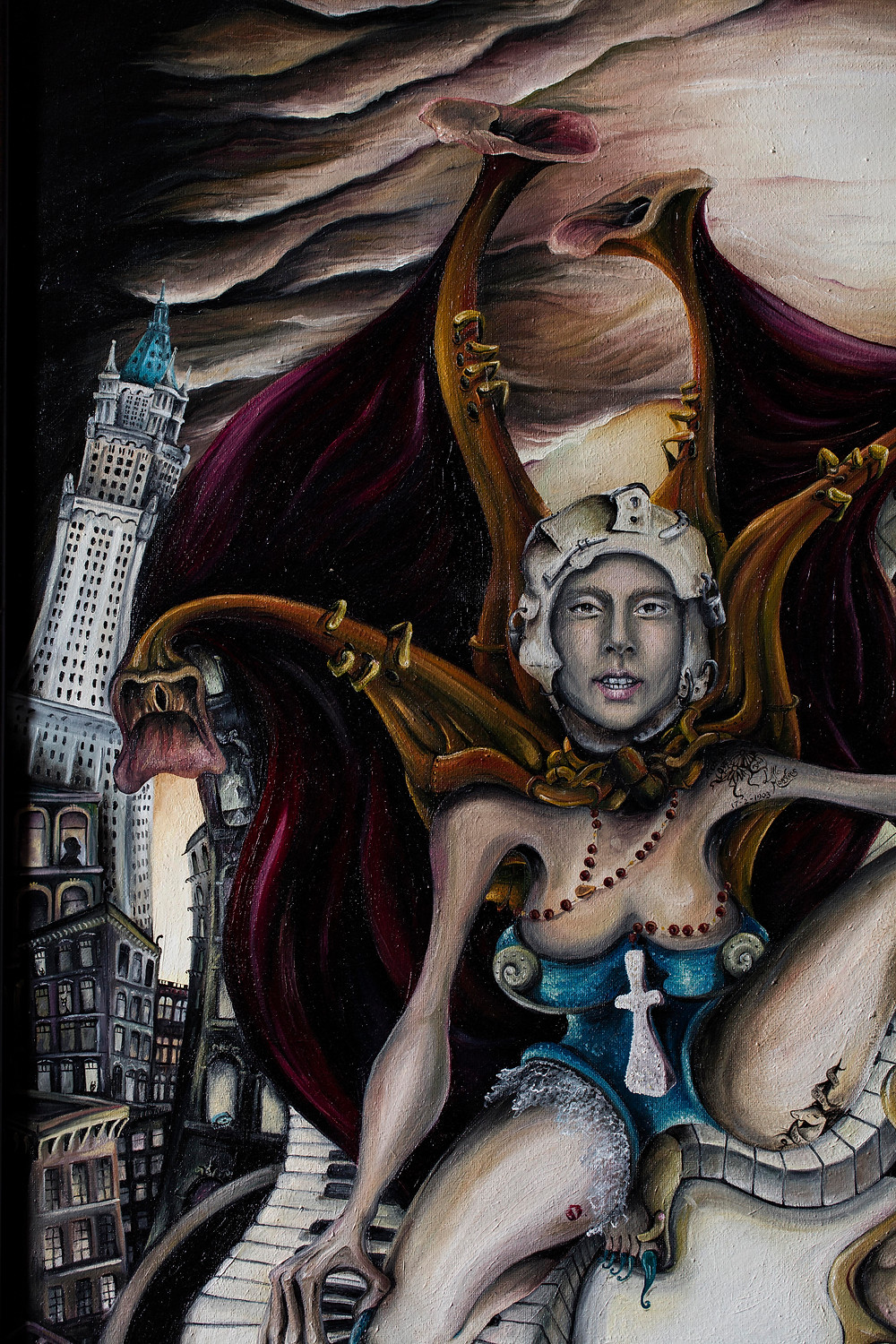 Welsh Artist Julia's Painting depicting the life and music of Lady Gaga created in 2012, here you see her face from beneath the glass mask, with her rosary and tattoos that mean a lot to her. One side Marilyn Monroe the other Marilyn Manson.