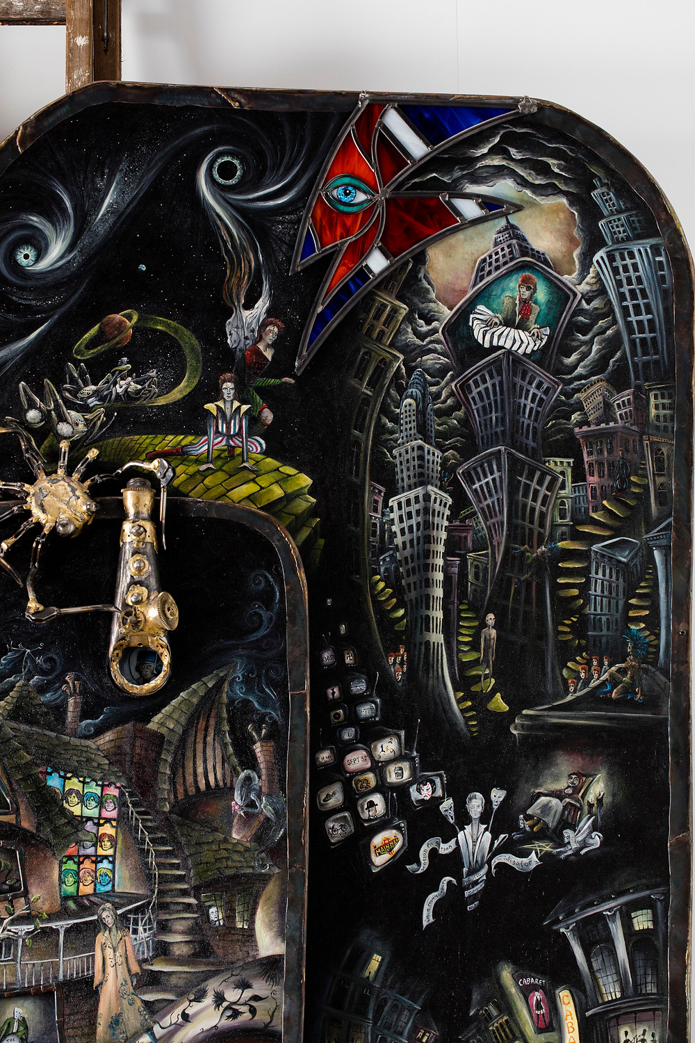 Welsh Artist Julia's Painting Depicting the life and music of David Bowie,  here is Ziggy Stardust and the Spiders from Mars, Major Tom looks towards Earth and Halloween Jack plays in New York