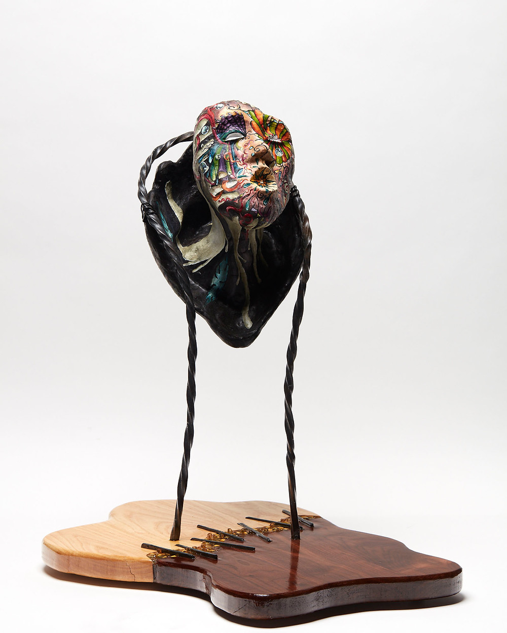 Sculpted oil painted head depicting the mental illness of Bipolar