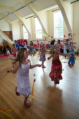 children spinning poi at a party