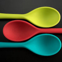 Three silicone spoons: yellow, rd, green