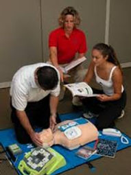 Three people simulating Pediatric Advanced Life Support (PALS)