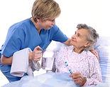 Nurse Show Care to Senior's Patient