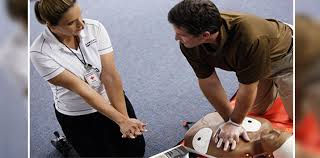 Instructor and Student simulating and performing First Aid CPR AED