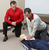 Johm performing CPR simulation