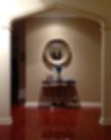 Decorative mirror in hallway.