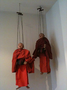 Oriental Puppets hangin from ceiling.