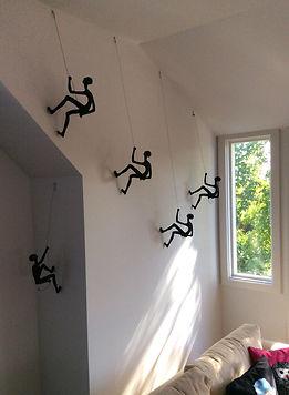 Climbing men wall sculpture.