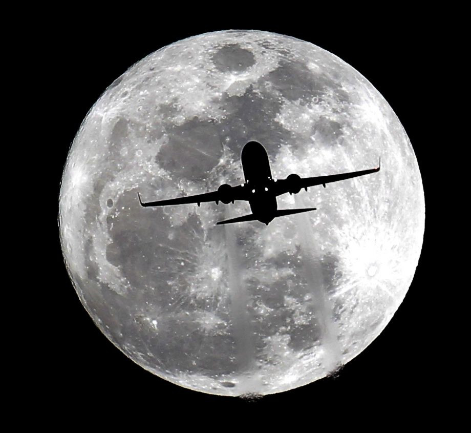 plane silhouette on moon.jpg