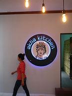 Jaruwan at Akha Kitchen logo