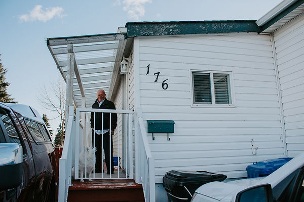 Tony Shwaluk standing in his mobile home at Midfield Park in Calgary