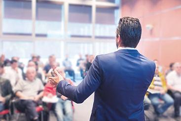 Man giving presenation in auditorium