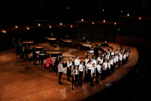 Eight pianists accompany the Corpus Christi Young Chorale