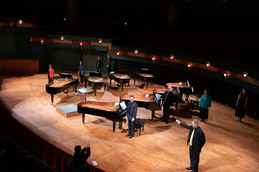 Dr. Brian Shelton and eight pianists