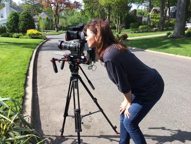 Elaine Del Valle with camera.jpg