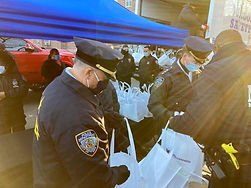 CPRF Teams with NYPD for Communities in need, Food & Coat Giveaway