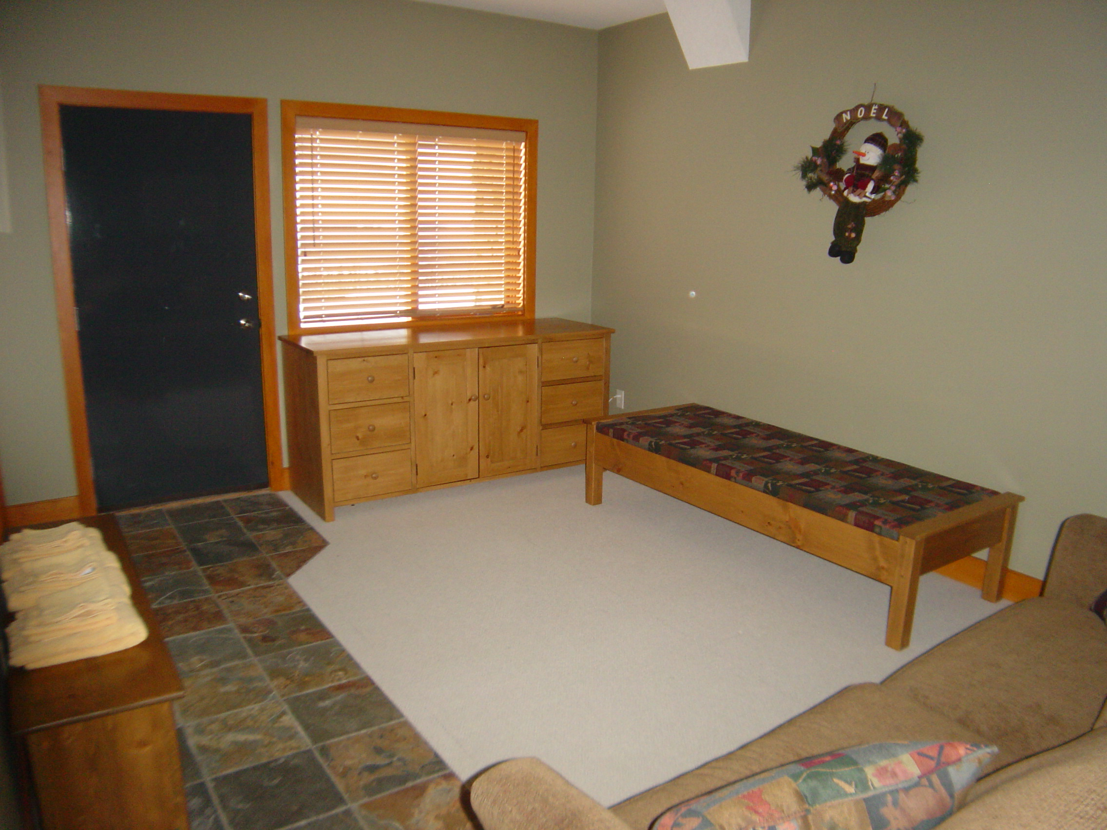 Downstairs family area with pull-out queen sofa-bed