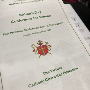 Schola Cantorum sings at Bishop's Day Mass