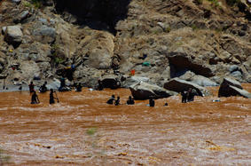 Gold hunters in the river water