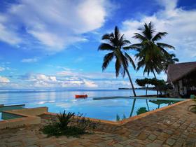 Swimming pool at Anjiamarango Beach Resort and Sylvain's trimaran