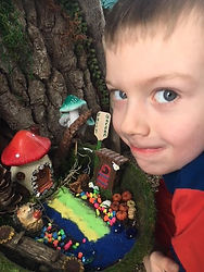 Boy with fairy garden