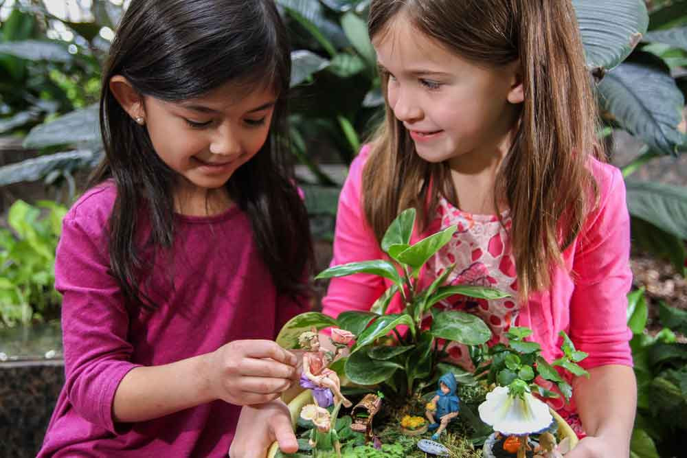 Girls playing with Flower Fairies