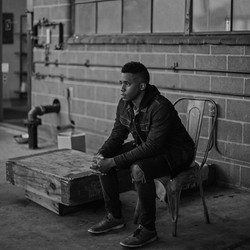 coffee shop Victor Artis sitting outside