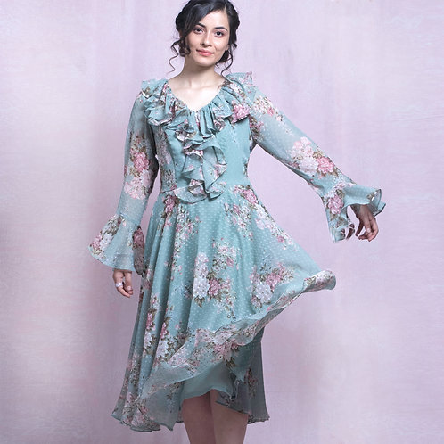 Pastel green floral dress with frilled neck and flared sleeves