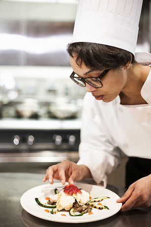 a-black-female-chef-working-in-a-commerc