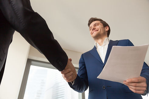 smiling-company-manager-welcoming-client