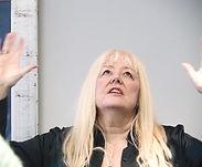 Pastor Lynn worshipping
