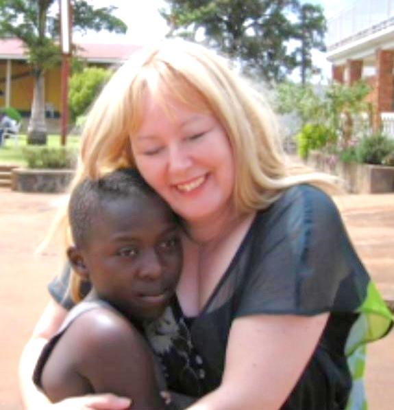 Pastor Lynn hugging Rwanda boy
