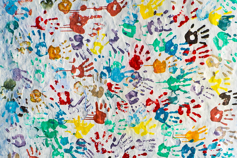 A lot of bright colorful handprints of c