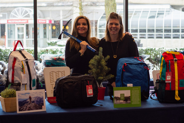 women displaying topo bags and gear