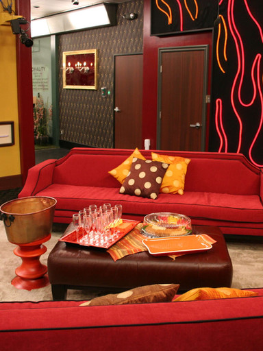 """Framed objects for """"Big Brother All Stars"""" on back wall of living room"""