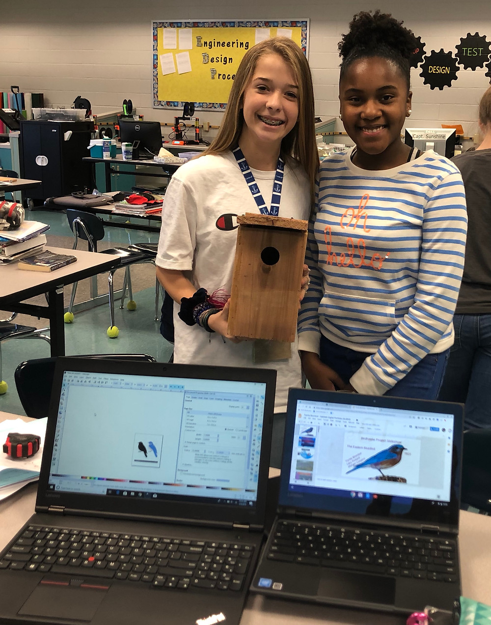Trinity Brumlow & Morgan Conyers show the progress of their group's research, as well as their birdhouse construction.
