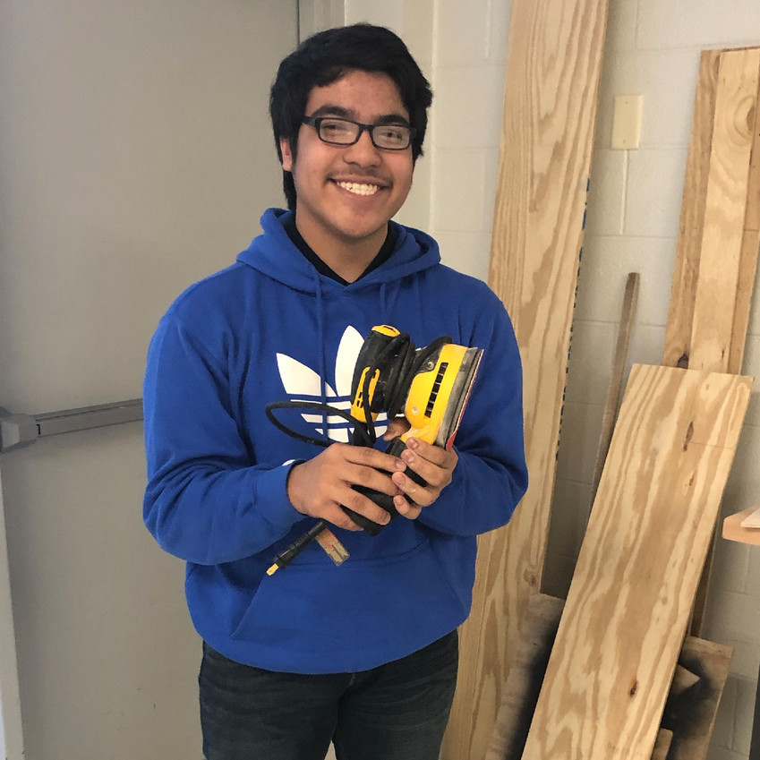 Franke poses with the sanding tool, his favorite tool for the project.