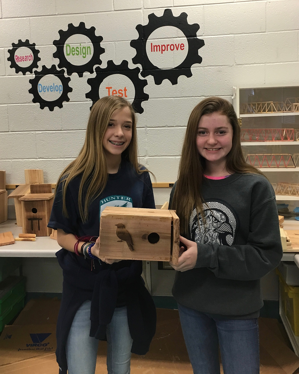 Trinity Brumlow & Lacy Pickard proudly show off their group's completed bird design.