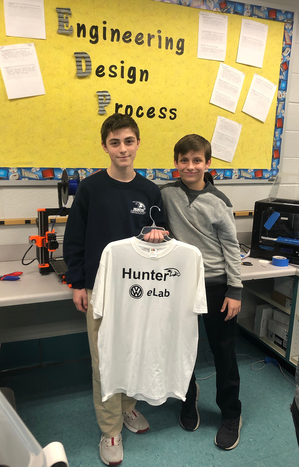 Class partners Mosier & Hook hold up one of the shirts created in the VW eLab.