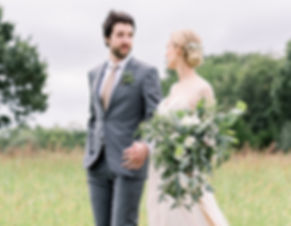 Brett & Emily walking in a field