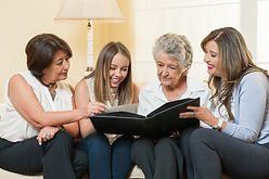 Women watching family album at home.jpg