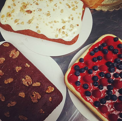 Rectangular carrot cake, brownies and red berries cheesecake