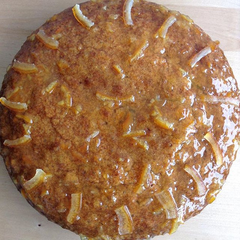 Carrot cake with orange marmelade and orange zest topping