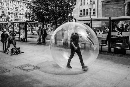 Man walking down the street in a bubble
