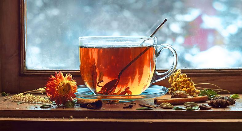 Tea cup with tea leaves on window. Tea t
