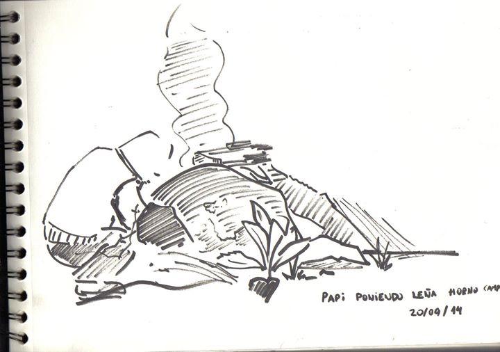 Papi poniendo leña horno campo