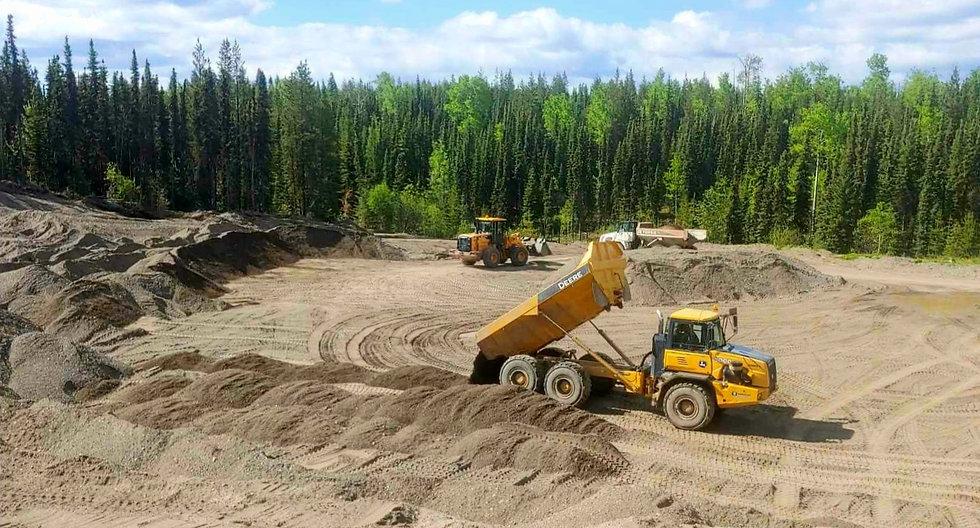 gravel pit construction site dump truck rock truck wheel loader