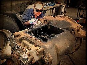 Man fixing a truck engine