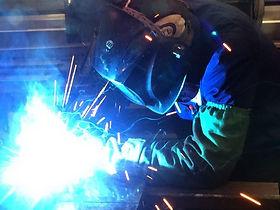 Universal Truck Service employee welding a truck trailer