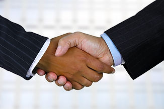 Black_And_White_Shaking_Hands.jpeg